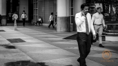 Man on the phone while smoking.
